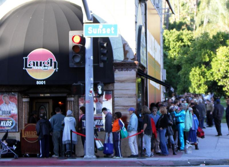 A line forms around the building as people wait to get a free Thanksgiving meal and comedy show at Jamie Masada's Laugh Factory. (Shotgun Spratling)