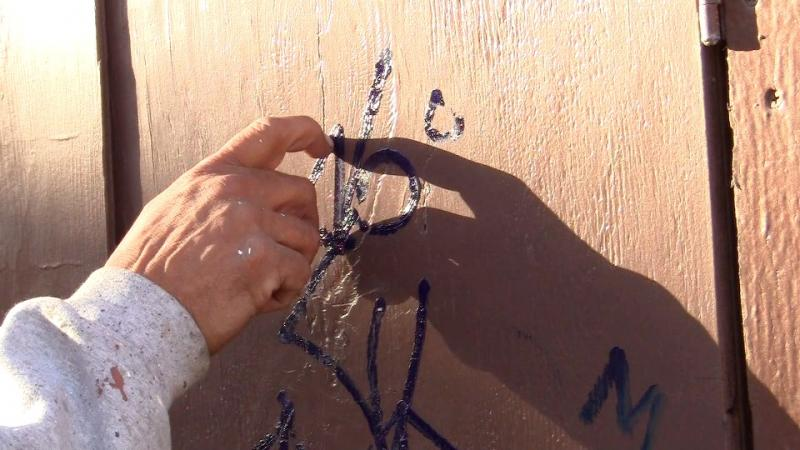 Muñoz inspects some fresh graffiti near Venice Beach