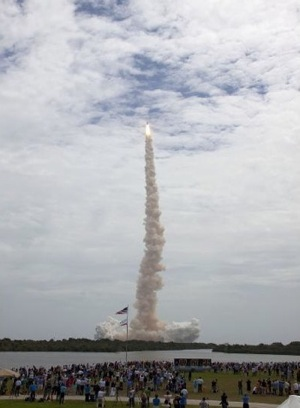 Atlantis lifts off for mission STS-135, the last space shuttle flight. Photo by NASA/Jim Grossmann/July 8, 2011