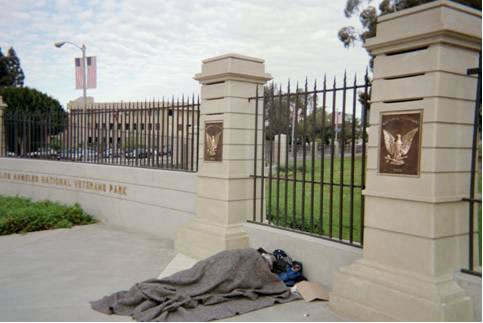 A homeless individual sleeps outside the V.A.'s West L.A. campus.(credit ACLU)
