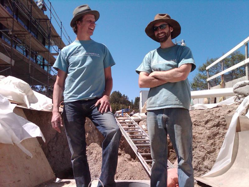 Scott Mathers (left) and Jeff Fuller (right) of Hey! Tanks L.A. take a break from installing an 8,000 gallon rain tank.