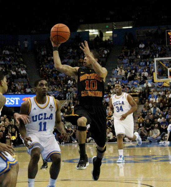 USC's Maurice Jones floats toward the basket before throwing a no-look lob pass against UCLA. (Shotgun Spratling)