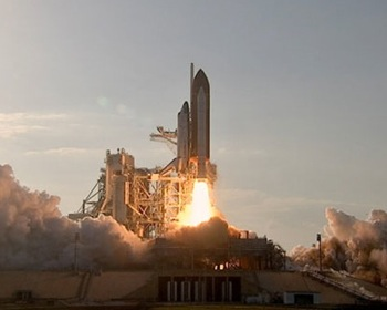 Space shuttle Discovery lifts off for STS-133 mission. Photo by NASA TV
