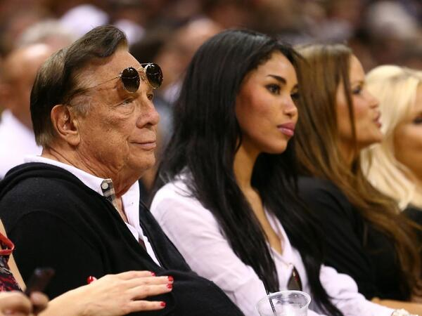 Clippers owner Donald Sterling and his girlfriend, V. Stiviano, sit courtside at a Clippers game. (Twitter/@RTNBA)