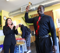 Clients ring the bell to signal new employment. (Changelives.org)
