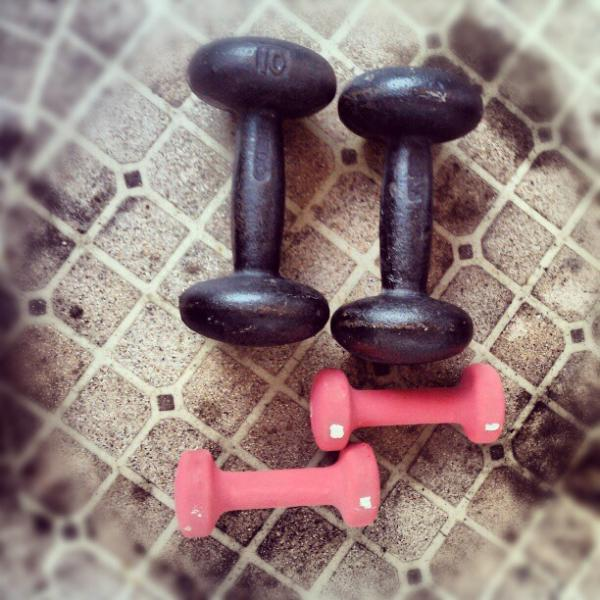 Use dumbbells to maximize your time on the treadmill. (Creative Commons/Flickr user celine nadeau)