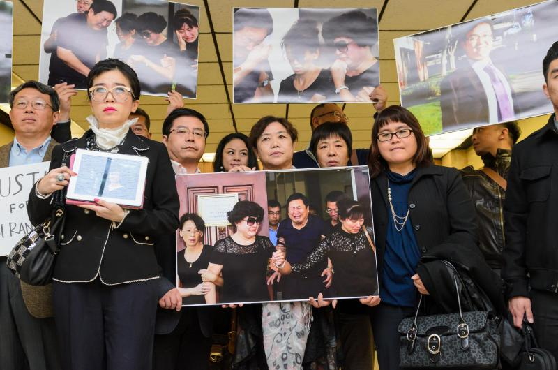 Supporters for Xinran Ji stand with Rose Tsai (second from left), attorney for Ji's family, after the preliminary hearing on 12/12/14 (Benjamin Dunn/Neon Tommy).