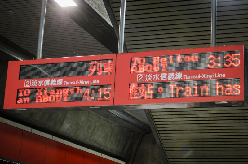 Time tables outside the gates at Shipai station. (Benjamin Dunn/Neon Tommy)