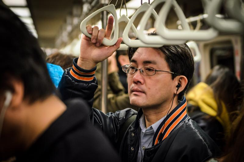A man waits on the Taipei MRT during New Year's Eve. (Benjamin Dunn/Neon Tommy)