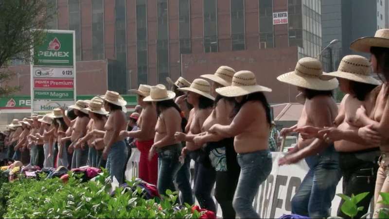 Members of the 400 Pueblos Movement strip down to their underwear and dance to music during their nude protest in Mexico this past January. (Photo courtesy of Anthony Alvarez)