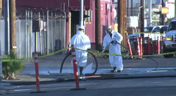 Crews clean up the mess from the oil spill. (@KTLA/Twitter)