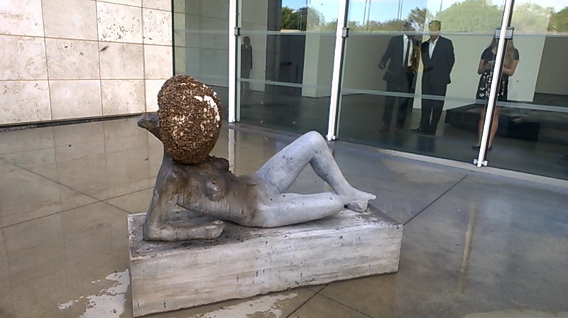 Bees cover this statue in Pierre Huyghe's LACMA installation. Photo by Vanessa Wilson.