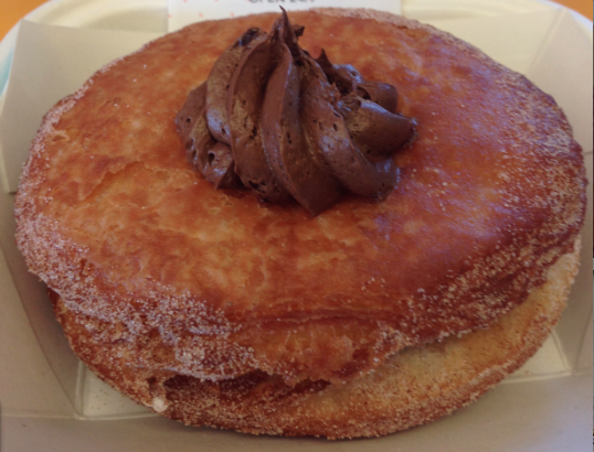 """""""The Original Nutella O-Nut,"""" a cronut filled with none other than some delectable Nutella, is just one of the flavor combos featured at DK's Donuts & Bakery in Santa Monica. (Janelle Cabuco, Neon Tommy)"""