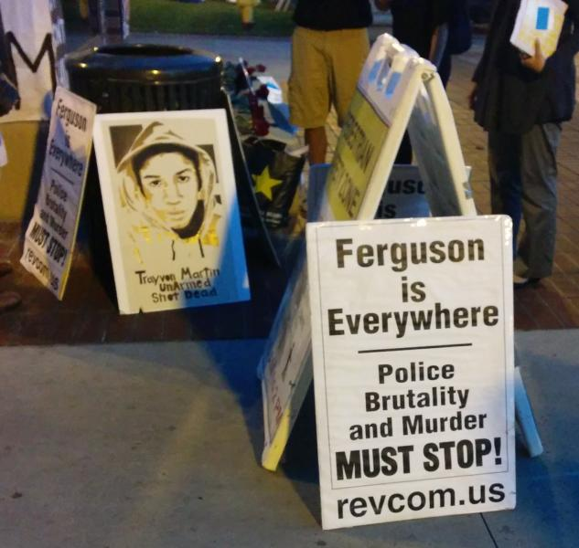 Posters put up by RCP supporter Keith James at the USC memorial for Mike Brown. (Sophia Li / Neon Tommy)