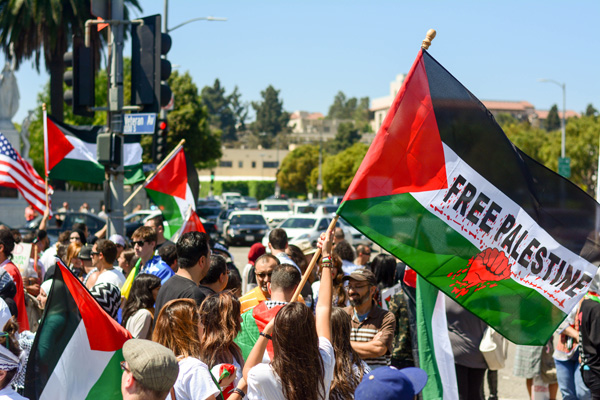 Flags and banners adorn the Palestinian side. (Matthew Tinoco/Neon Tommy)