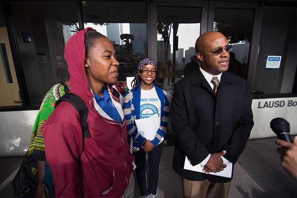 Simone Al-Alim and her father Kahllid speak to the press outside of LAUSD's Downtown Headquarters. (Matthew Tinoco/Neon Tommy)