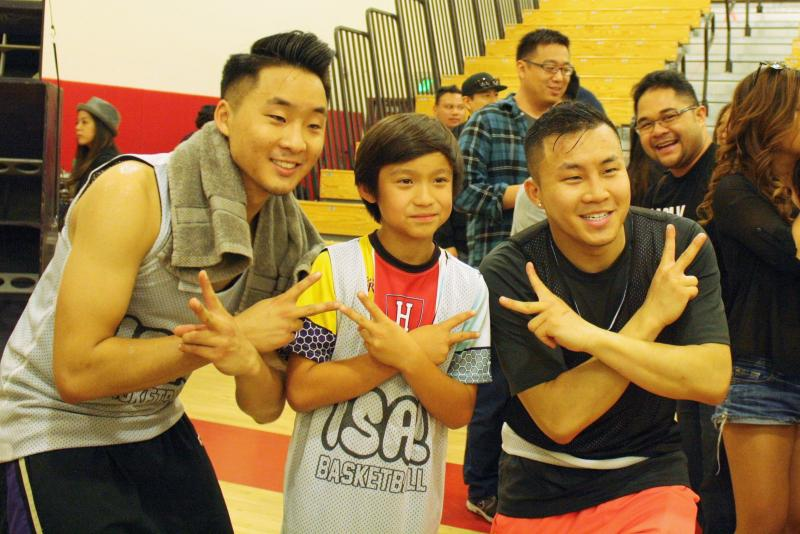 "Andrew and David Fung of FungBrosComedy pose with ""Fresh Off the Boat"" star Forrest Wheeler. (Heidi Carreon/Neon Tommy)"