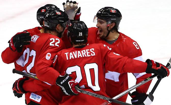 John Tavares celebrating with Canadian teammates before his injury (Facebook / NHL).