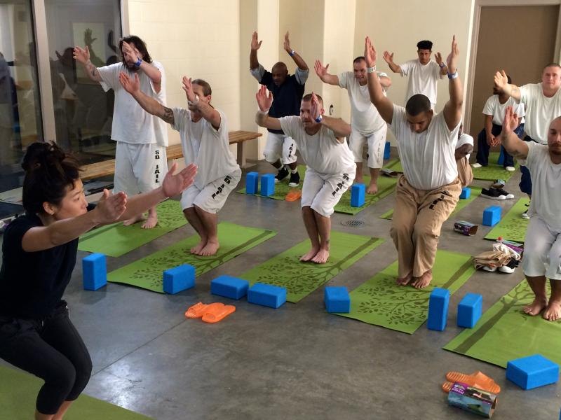 Veteran Inmates Doing Yoga (Margaux Farrell/Neon Tommy)
