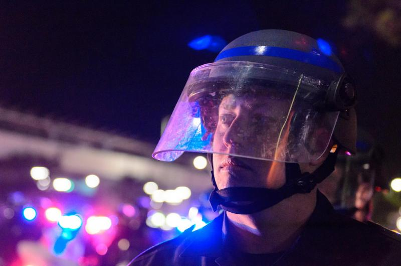 A LAPD officer watches the march. (Benjamin Dunn/Neon Tommy)