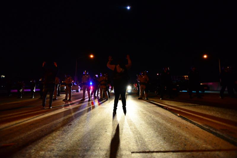Protesters shut down the 110 freeway as police officers surrounded them. (Charlie MacGovern/Neon Tommy)