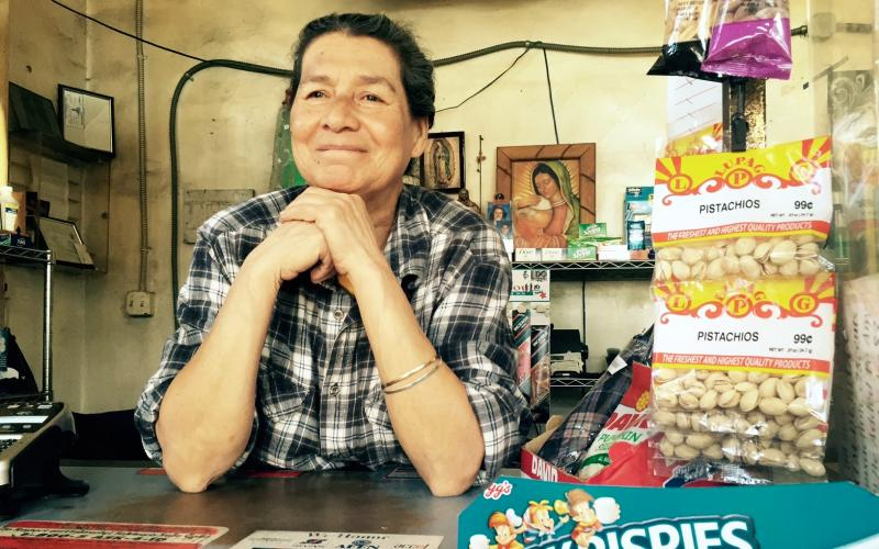 Brigid Estrada stands behind the counter of her convenience store, where she has witnessed many accidents involving the Metro. (Daniel Jimenez/Neon Tommy)