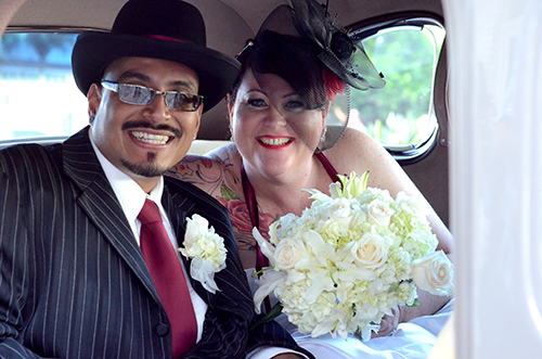 Eduardo and Michelle Reyes leave their ceremony in style. (Photo by Hillary Jackson/Neon Tommy.)