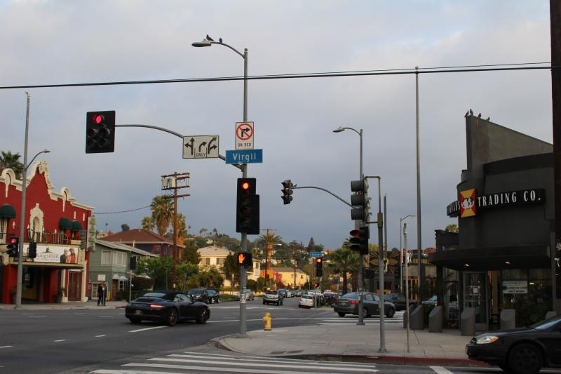 Drivers turn from Sunset Boulevard onto Sunset Drive at this six-point intersection in Los Feliz. A Crossroads Trading Co. employee (store pictured on right) said the confusing turn leads drivers to swerve close to the store. (Matt Lemas/Neon Tommy)