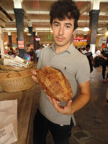 Clark Street Bread's Zack Hall shows off his goods. (Sara Tiano/Neon Tommy)
