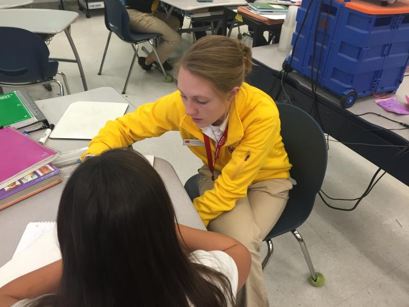 A City Year member helps a student with her homework during an after-school session (Diana Lee/Neon Tommy).