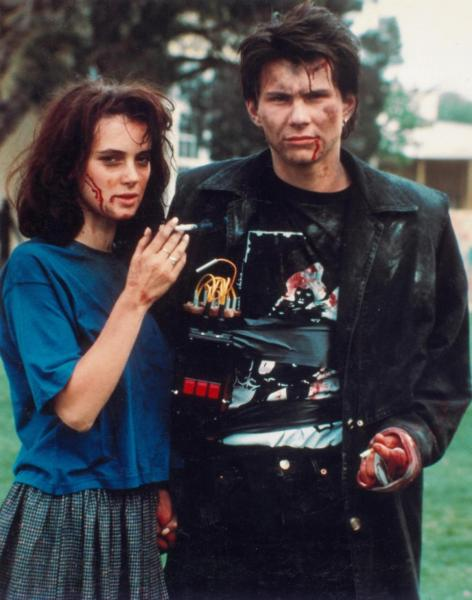 "Winona Ryder and Christian Slater as Veronica Sawyer and JD in ""Heathers"" (1989)."