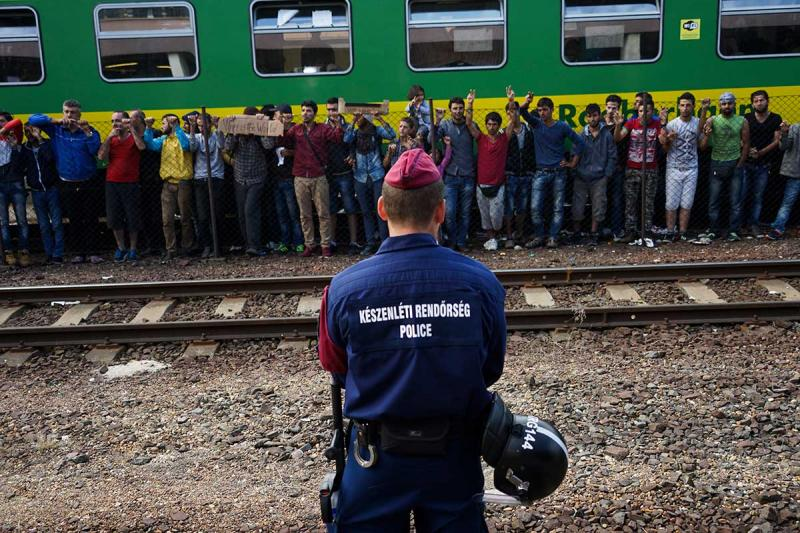 Syrian refugees strike at a platform in Budapest in September. At least half of U.S. governors are refusing to take in Syrian refugees following the attacks on Paris. (Mstyslav Chernov, Creative Commons)