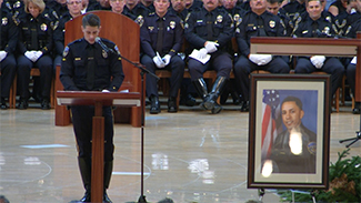 Fellow Downey Police Officer Drew Lofquist delivers a eulogy at Officer Ricky Galvez's funeral on Mon., Nov. 30, 2015.
