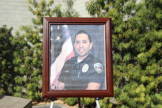 A memorial for Officer Ricardo Galvez was created in front of Downey Police headquarters on Thursday, Nov. 19, 2015. (Whitney Ashton/Annenberg Media)