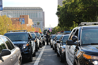 Rows of police cars and other law enforcement vehicles line the streets in front of the cathedral in Downtown Los Angeles. (Whitney Ashton/Annenberg Media)