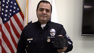 Los Angeles police Sgt. Dan Gomez, of the LAPD Tactical Technology Section, demonstrates the use of a body camera on Wed., Nov. 25, 2015. (Whitney Ashton/Annenberg Media)