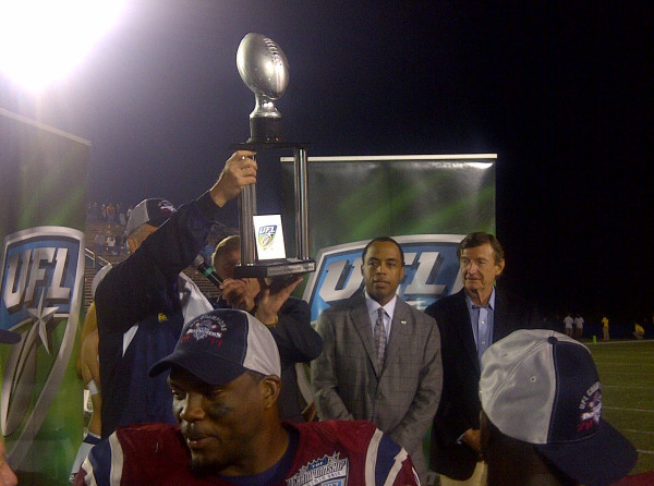 Marty Schottenheimer hoists the championship trophy after the Destroyers' victory on Friday. (Twitpic user jennyereynolds)