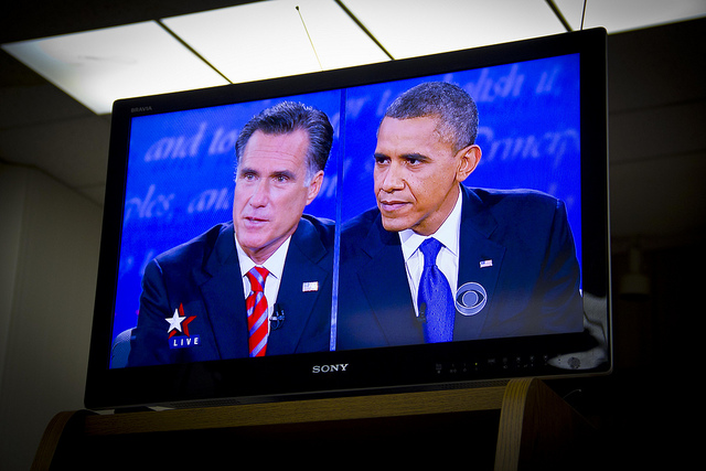 Obama and Romney on screen during a debate watching party Monday night in Arcadia, California.(Rosa Trieu/Neon Tommy)