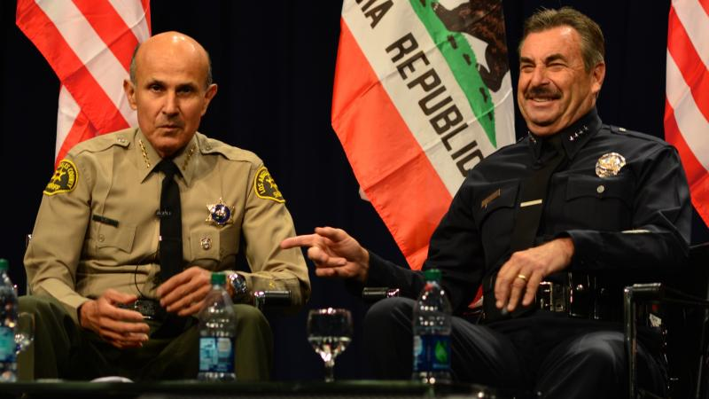 L.A. County Sheriff Lee Baca and City of L.A. Police Chief Charlie Beck discuss human trafficking at the University of Southern California on Friday, Nov. 16. (Alan Mittelstaedt)