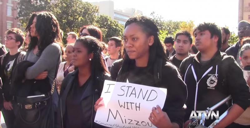 A USC student holds up a sign at a rally on campus. (ATVN)