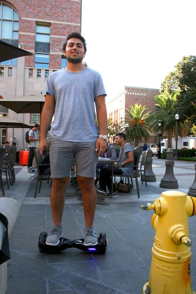 USC student Ethan Mezrahi rides his board between classes. (Photo by Madeline White, Annenberg Media)