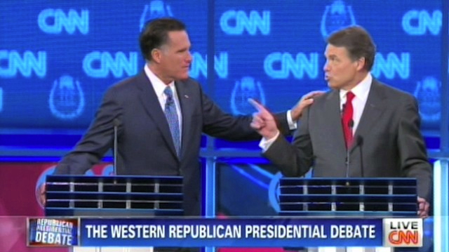 Mitt Romney and Rick Perry have a touching moment at the Tuesday debate in Las Vegas, Courtesy of CNN