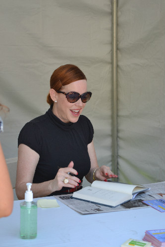 Ringwald signing books after the talk (Kristin Yinger/Neon Tommy).