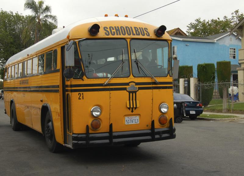 A school bus awaits the students outside Lindsay's College-Ready Academy High School.