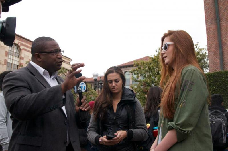 ABC 7 interviews two students who attended the party. (Faith Jessie/ Neon Tommy)