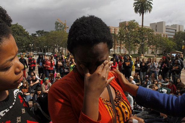 Makiah Green tears up during the rally. (Aaron Liu/ Neon Tommy)