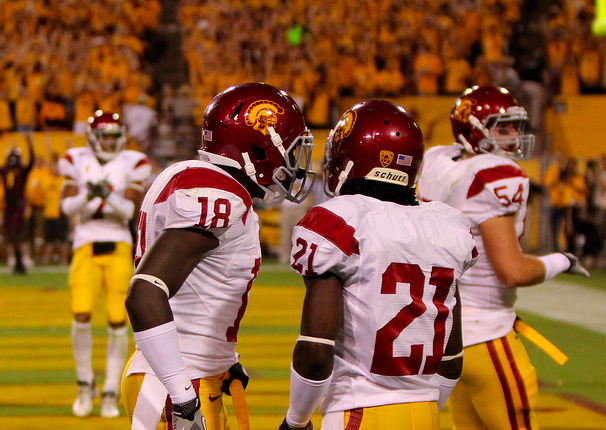 Bailey (18) and Robey (21) couldn't get USC a victory over Luck. (James Santelli/NT)