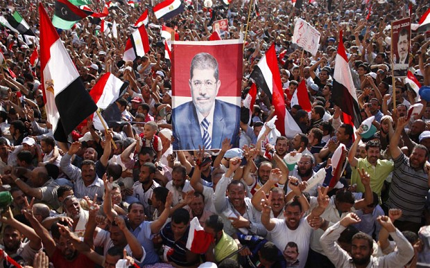 The Egyptian people cheer the election of their new president, Mohammed Morsi. (Reuters)