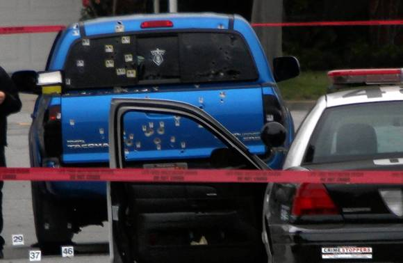 The two women were sitting in this truck when officers opened fire. (Los Angeles Times)