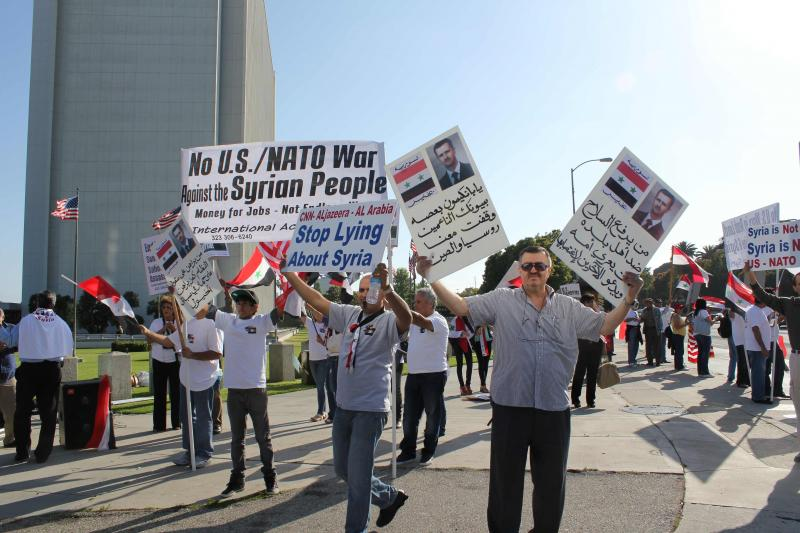Assad supporters told the media to stop lying about the regime's handling of the violence. (Shako Liu/Neon Tommy)
